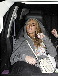 "Lohan, seen wearing the ""Unisex Flex Fleece Zip Hoody"" in speckled gray."