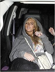 "Lohan, seen wearing the ""Unisex Flex Fleece Zip Hoody"" in speckled gray."